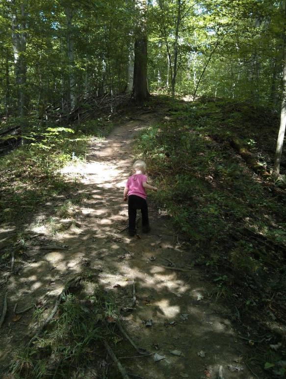little girl hiking on trail
