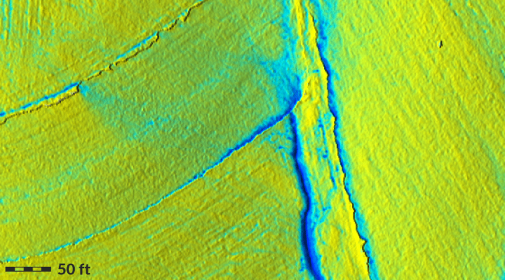 Water flow on patched DEM showing pooling effects around discontinuities